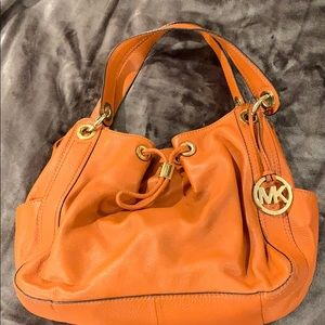 Michael Kors orange leather satchel